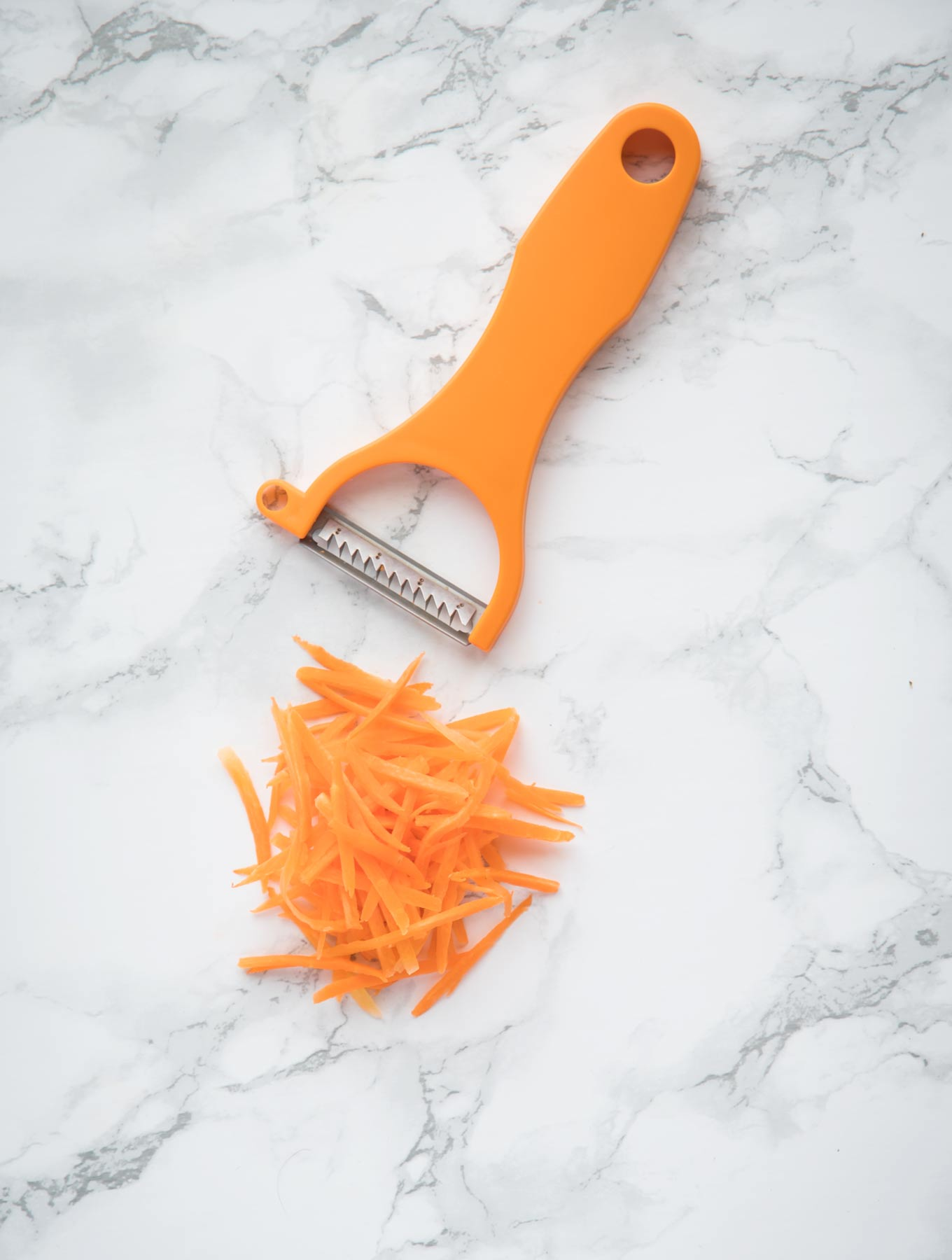 Carrots cut with a julienne cutting tool.