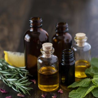Essential Oils Amber jars vials Rosemary lemon mint rose