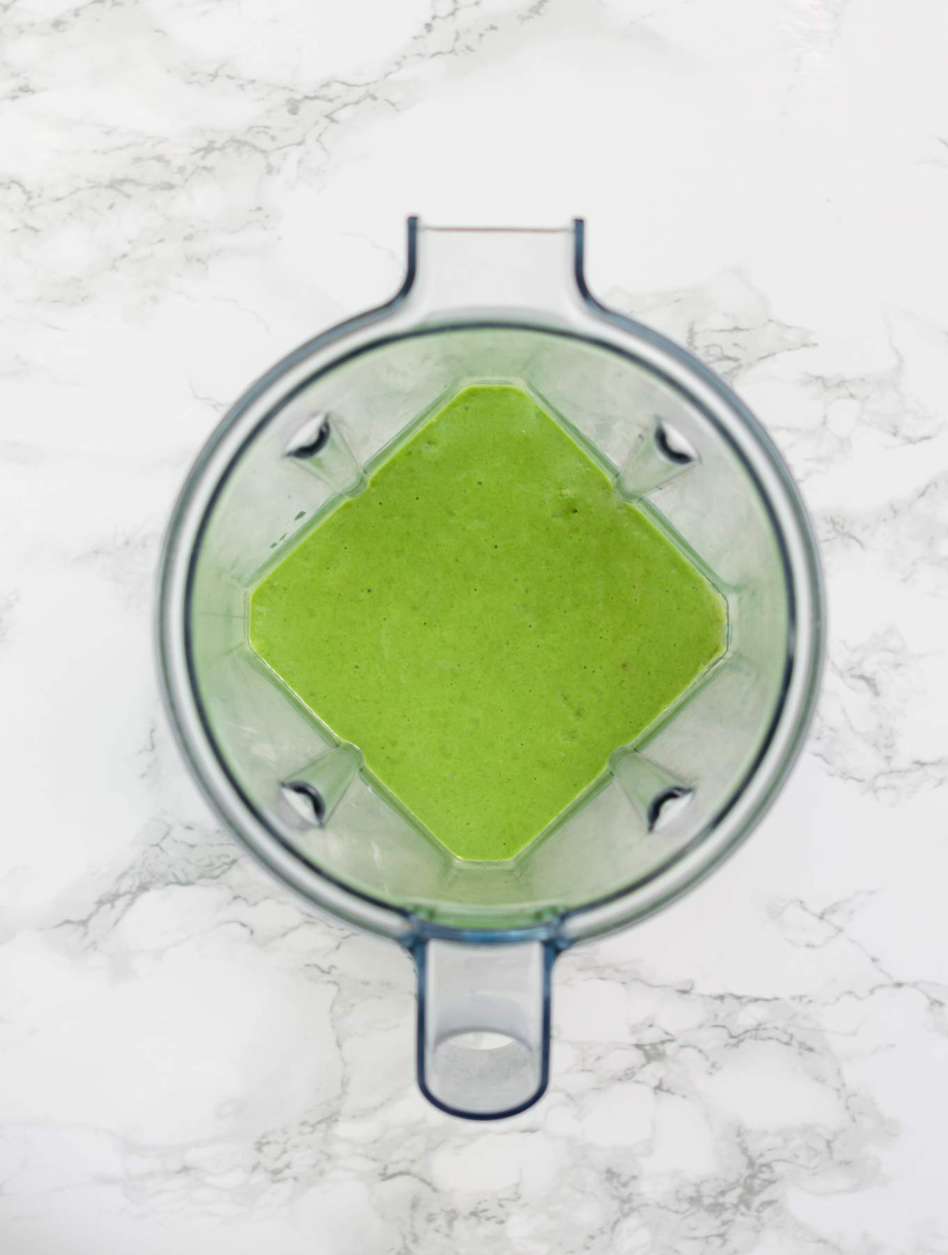 Blended green smoothie in blender