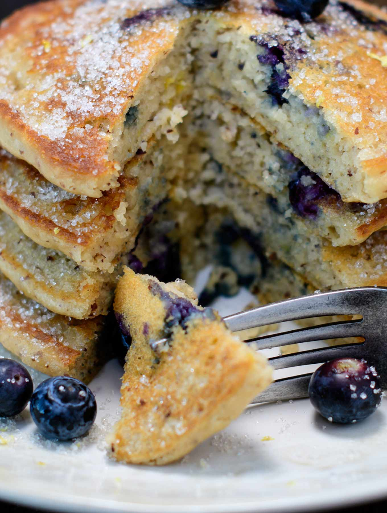 Stack of gluten free lemon blueberry pancakes with a fork