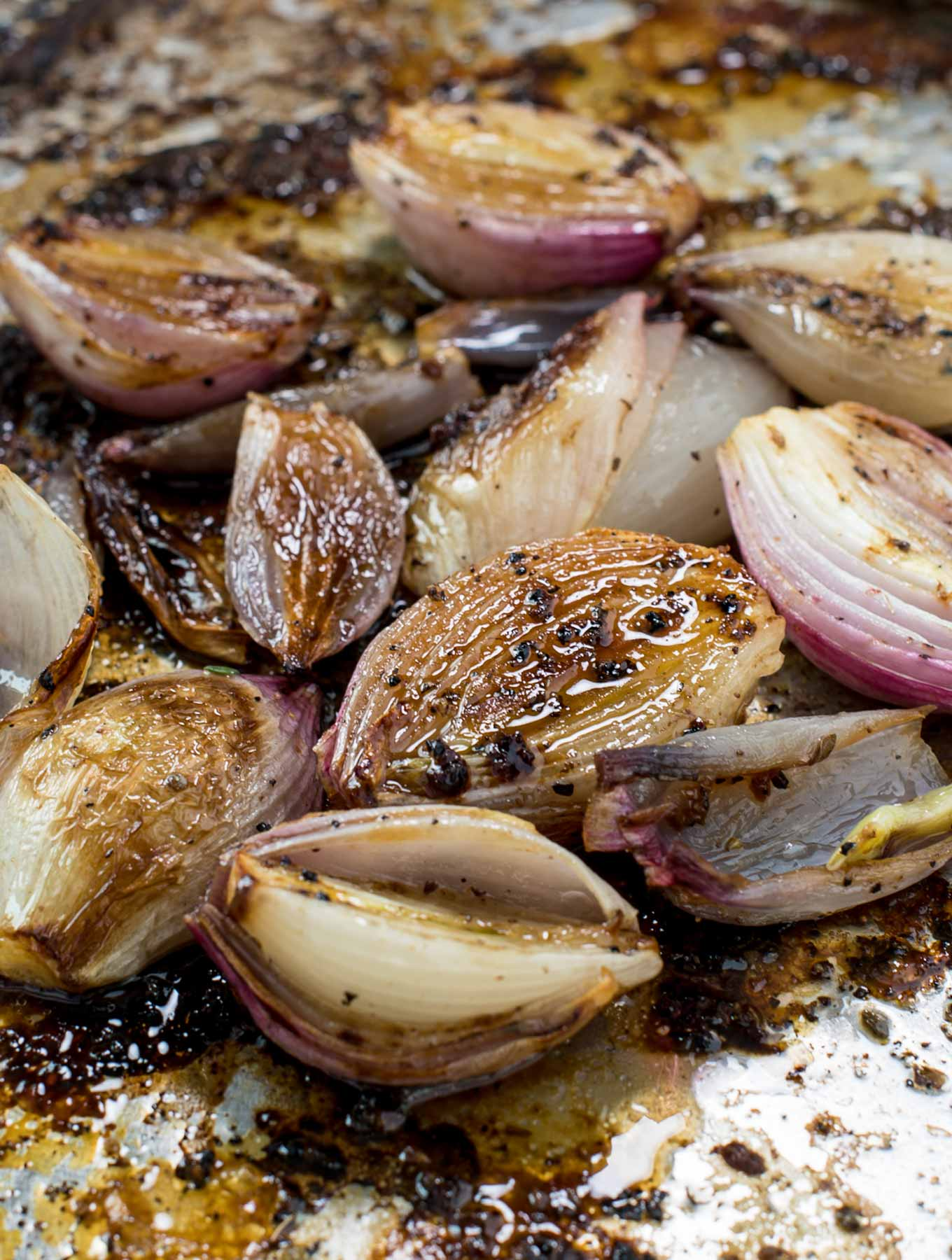 Roasted shallots in a roasting pan