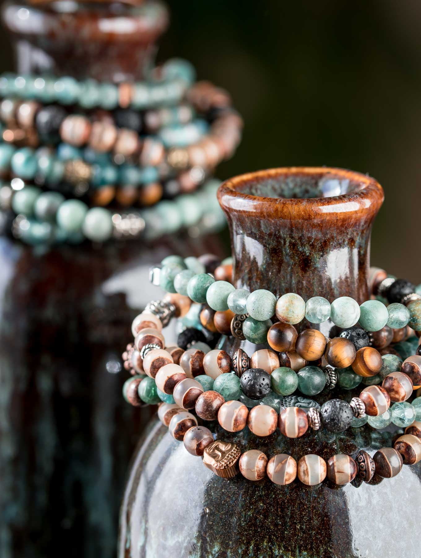 Essential oil diffuser bracelets on a bottle