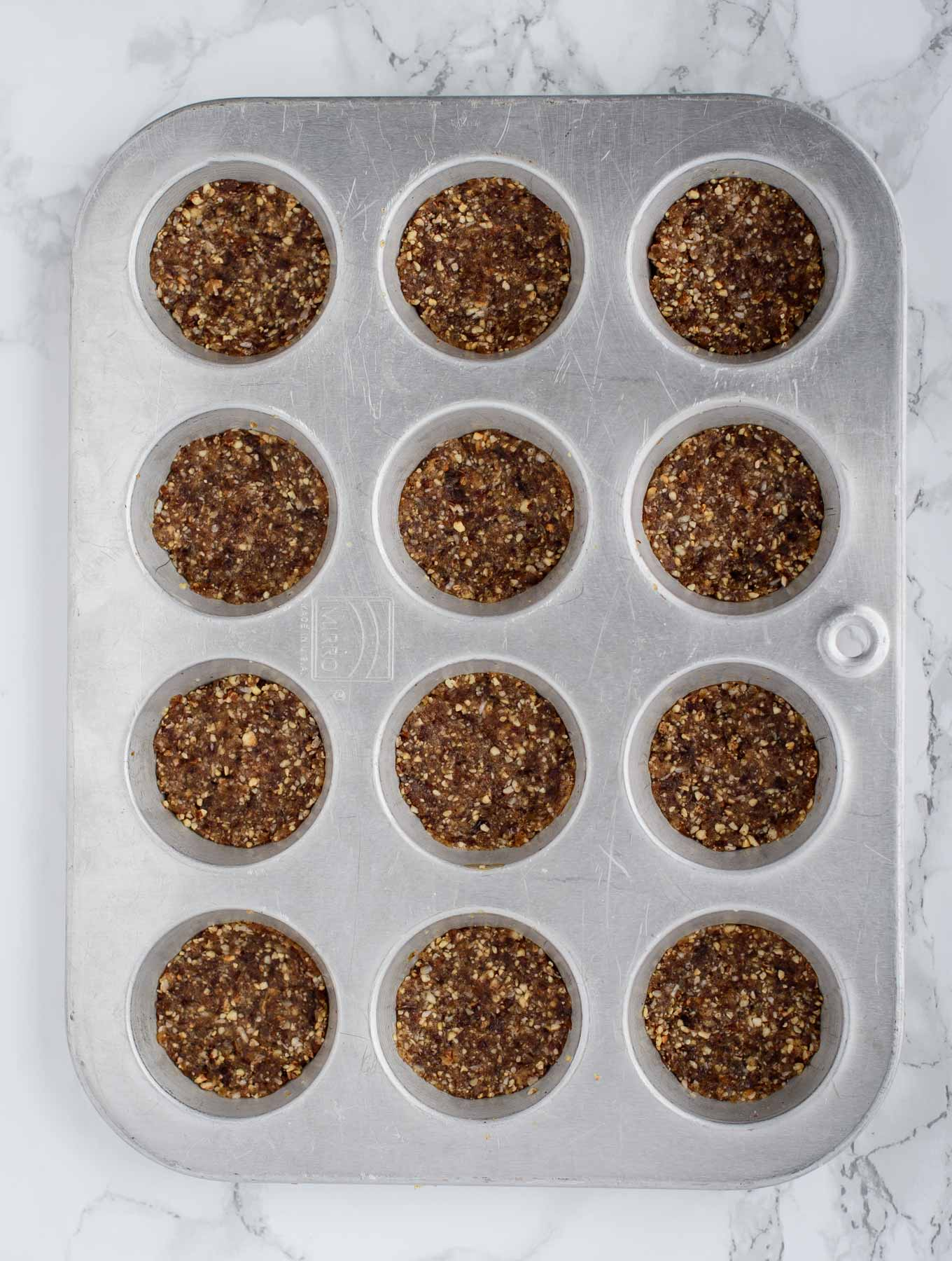 Candied ginger crust in muffin tin