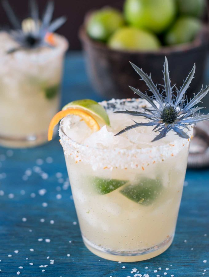 Brazilian margarita with citrus salt on a blue board