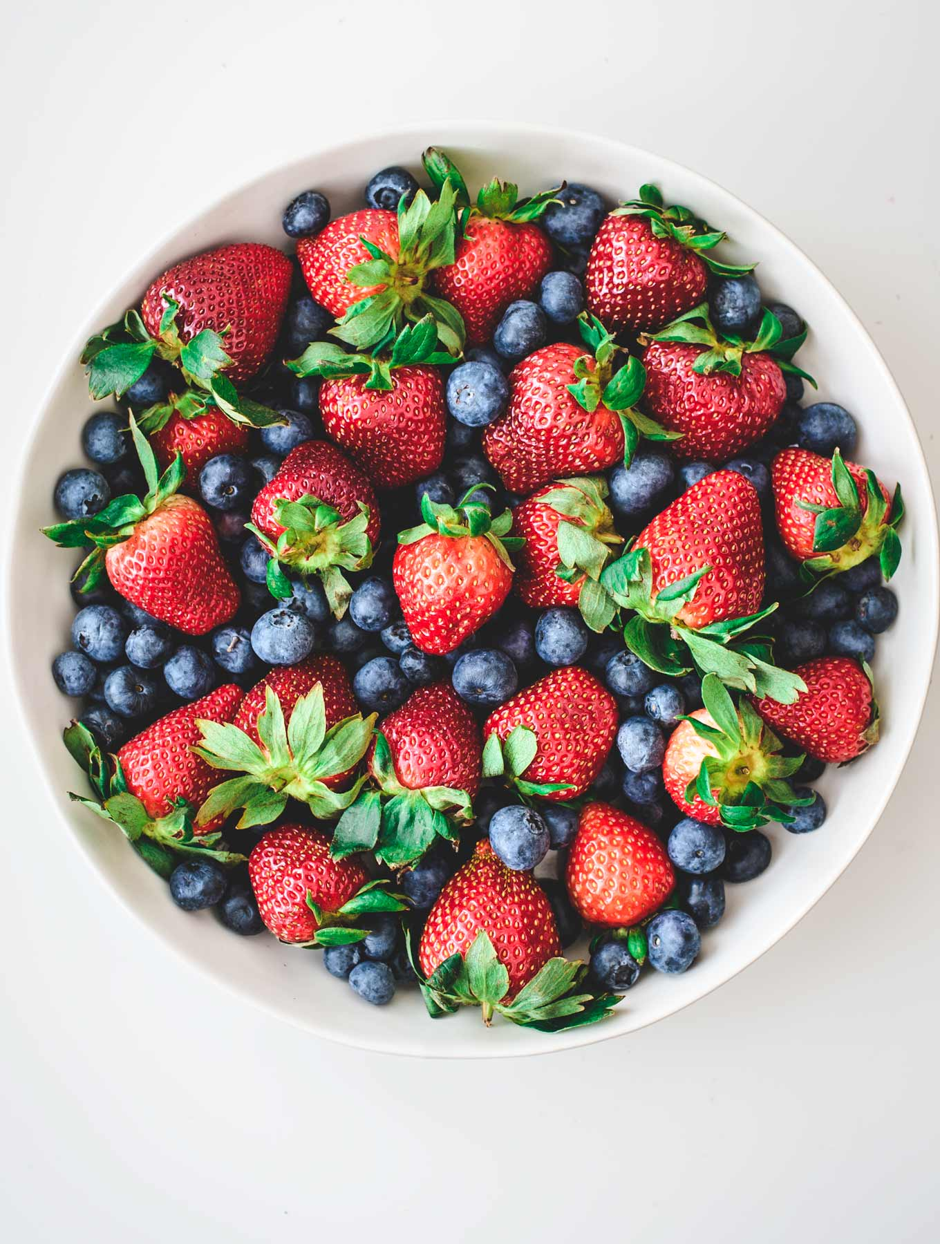 Bowl of fresh strawberries and blueberries