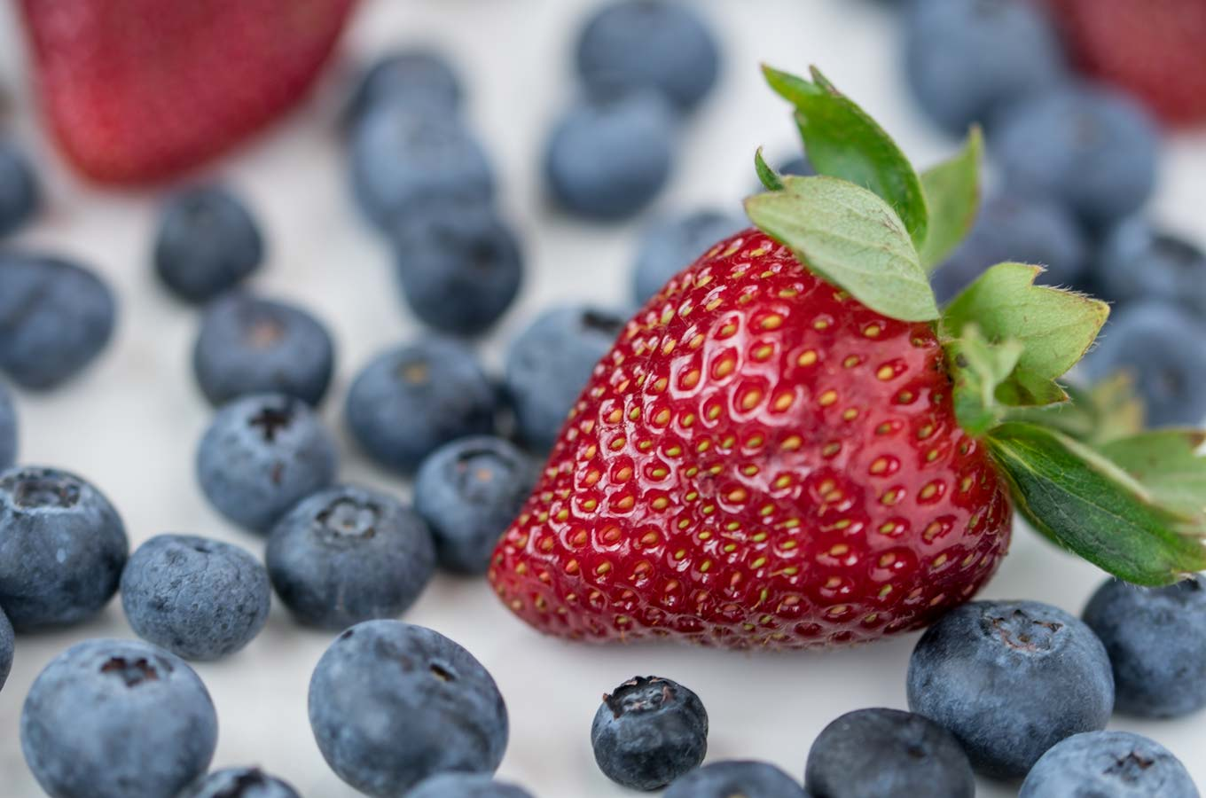 close up of strawberry and blueberries