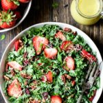 Bowl of Strawberry Kale Salad with Lemon Basil Dressing
