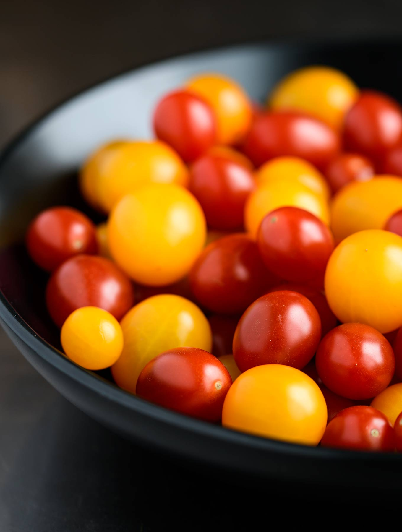 Bowl of yellow and red grape tomatoes