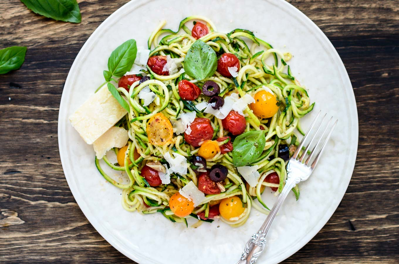 Zucchini Pasta with tomatoes and olives on a plate