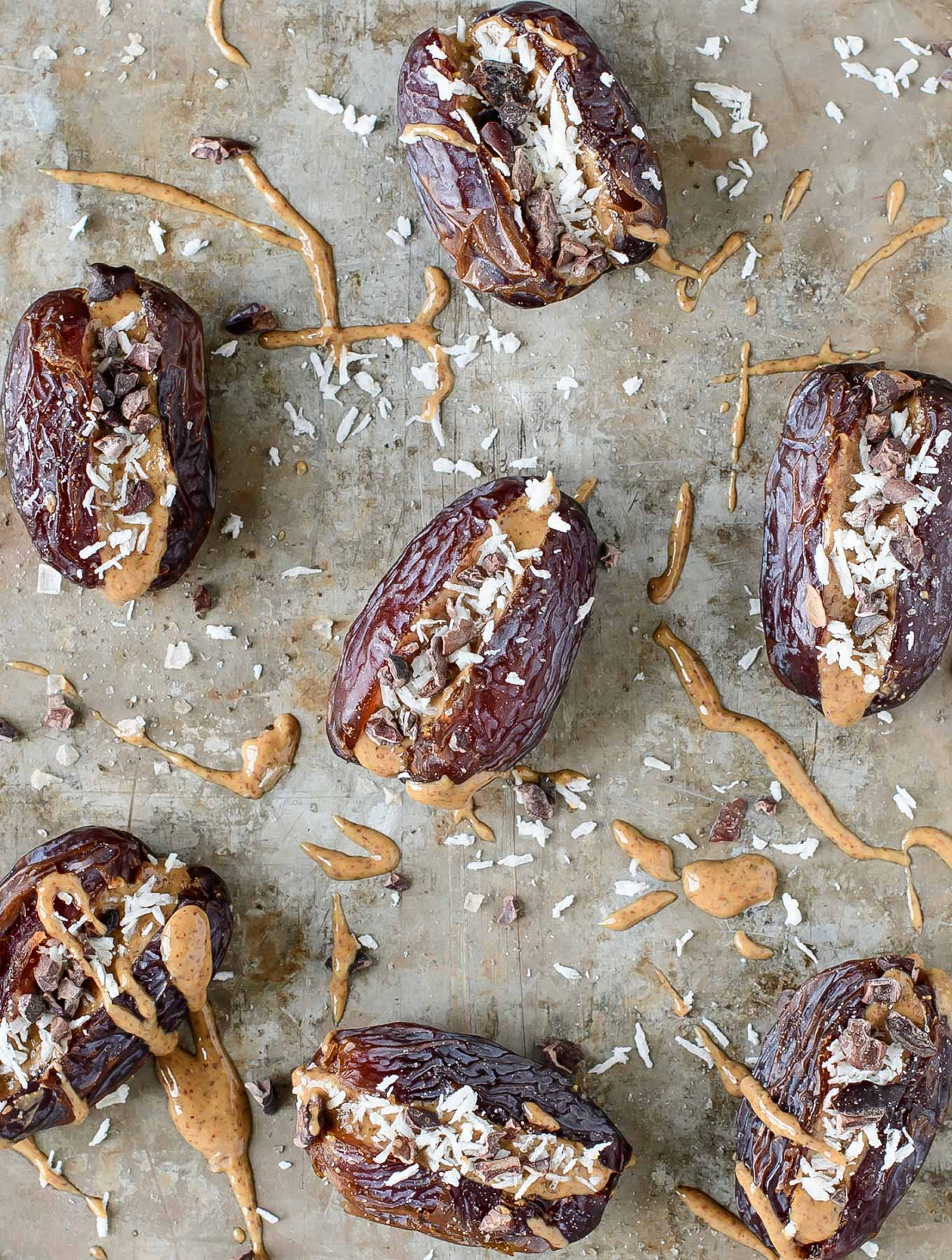 Dates stuffed with almond butter, coconut, cacao nibs and smoked salt.