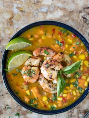 Bowl of corn chowder with shrimp on top