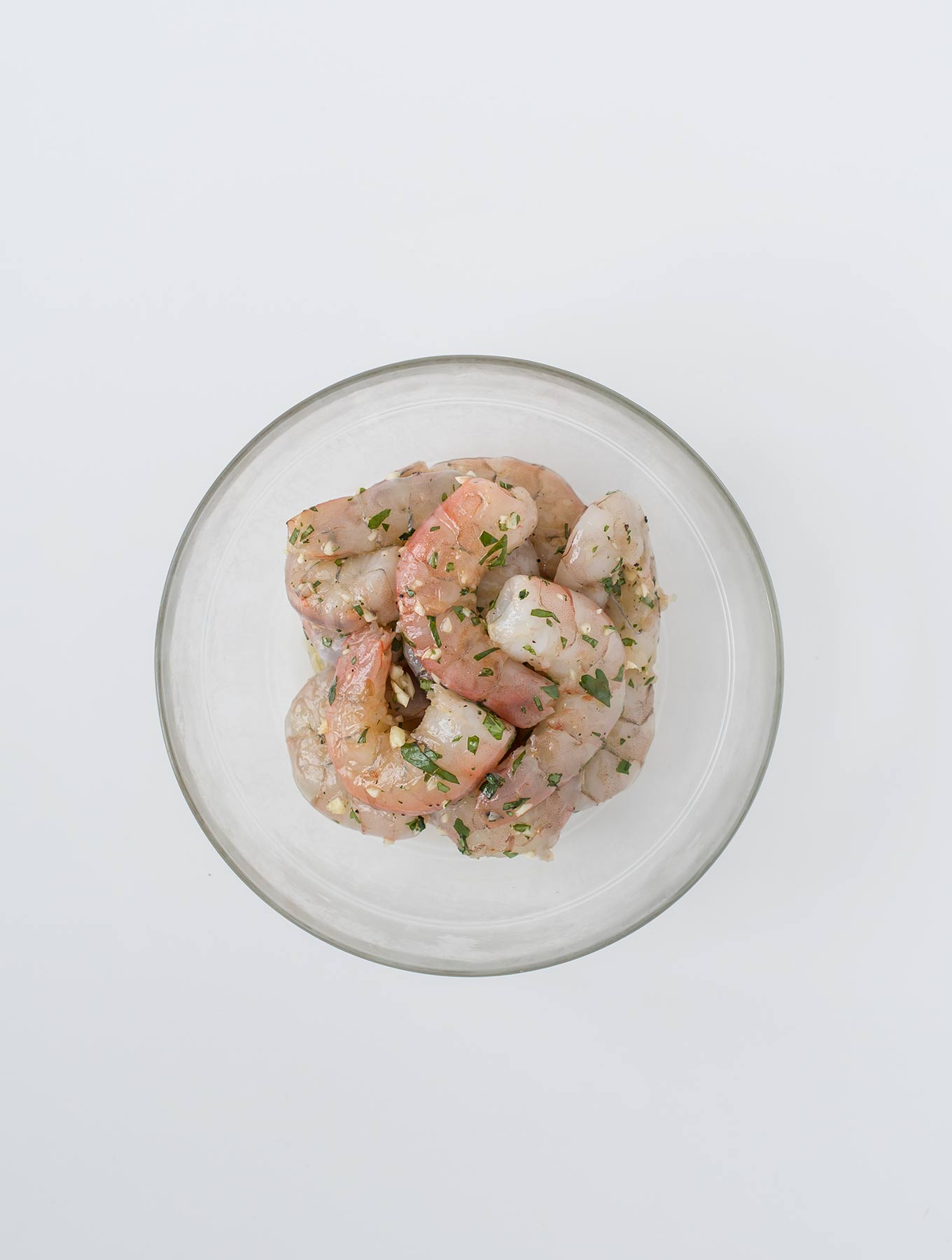 Bowl of raw shrimp in marinade