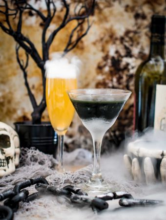 Two halloween cocktails in a spooky scene