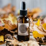 Bottle of fall room spray with leaves
