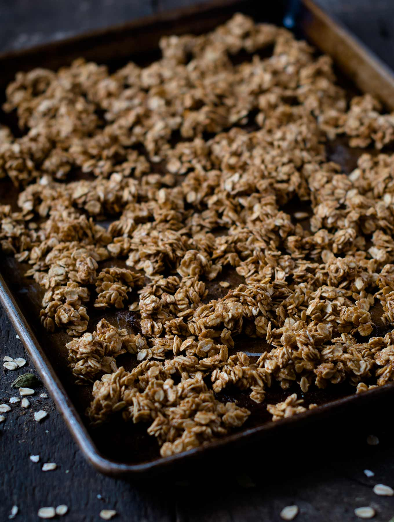 Maple cardamom granola on a baking sheet