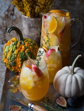 two glasses of Fall harvest sangria and a pitcher