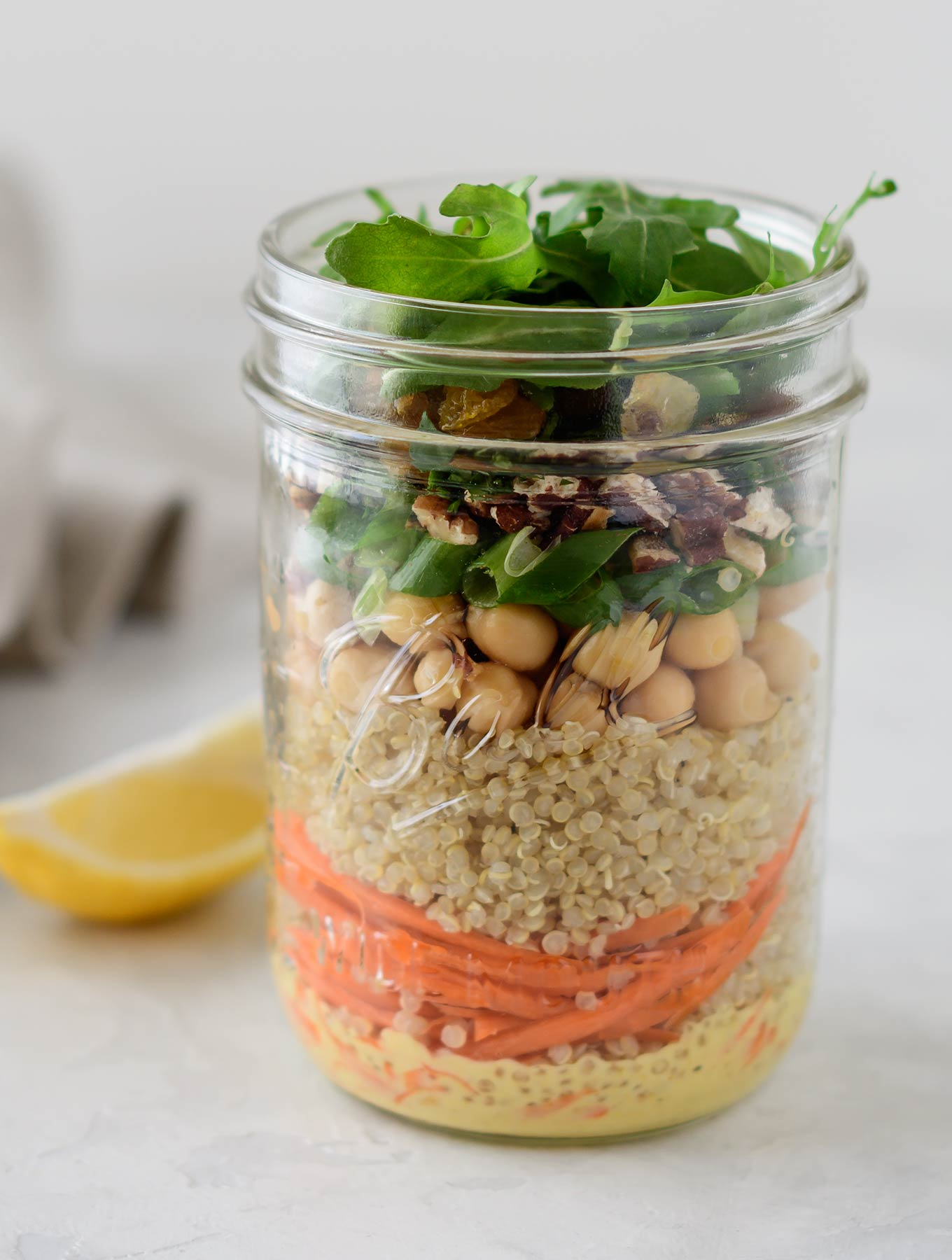 Jar of Moroccan quinoa salad with curry dressing