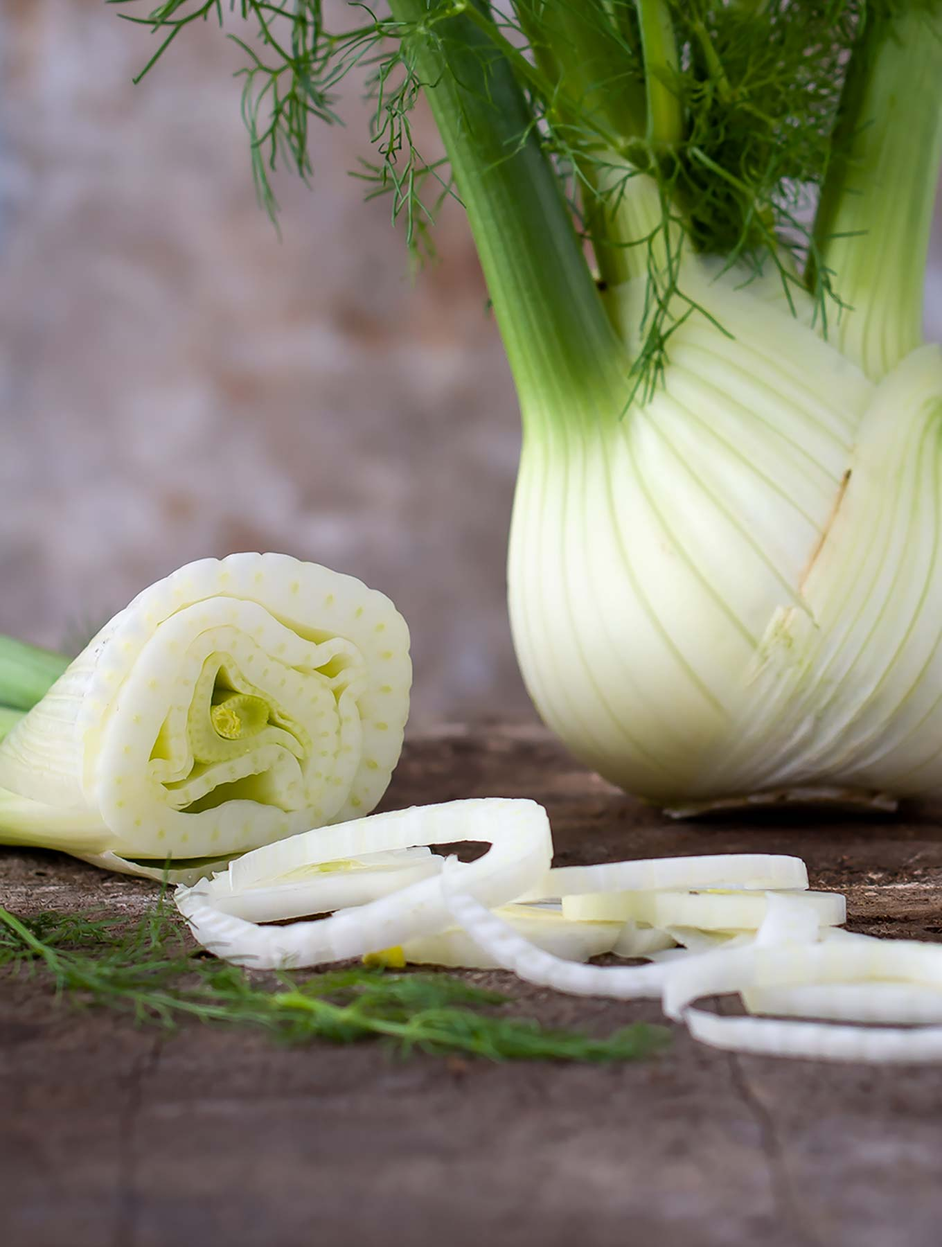 Cut up fennel on a wooden surface