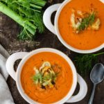 Two bowls of creamy tomato fennel soup