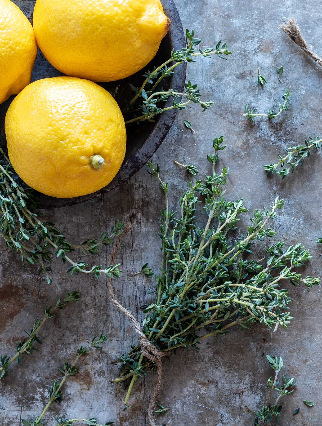 bowl of lemons with thyme