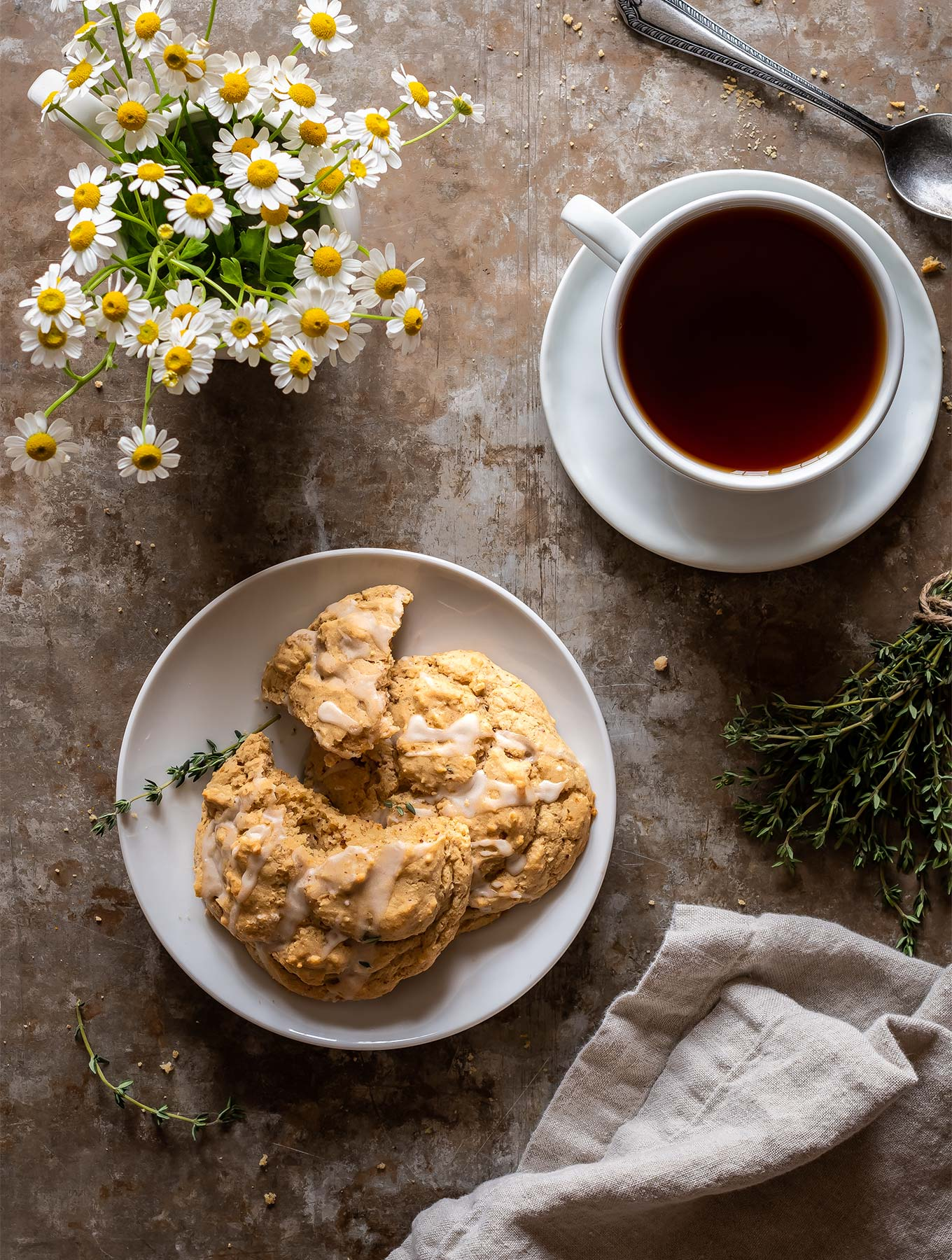 Overhead lemon thyme scones with a cup of tea and flowers
