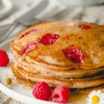 Close up stack of raspberry lemon pancakes