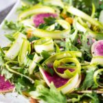 Plate of shaved asparagus salad and watermelon radish