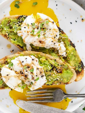 Two pieces of avocado toast on grilled bread
