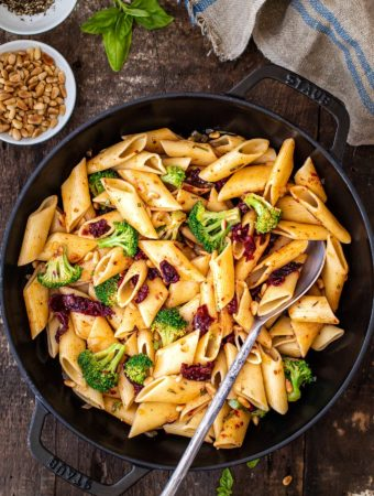 Skillet of pasta with sun dried tomatoes and broccoli