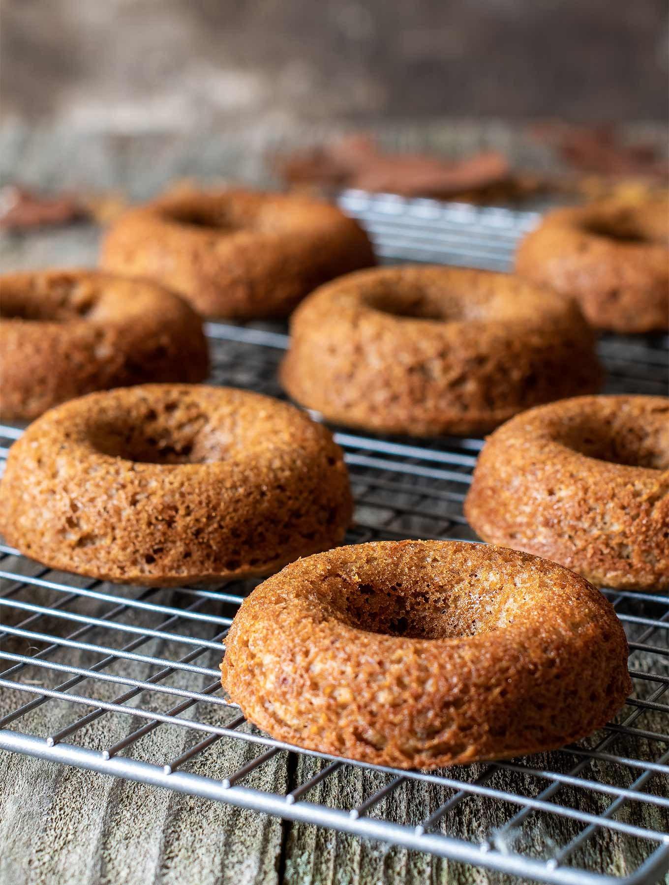 cardamom donuts on a cooling rack