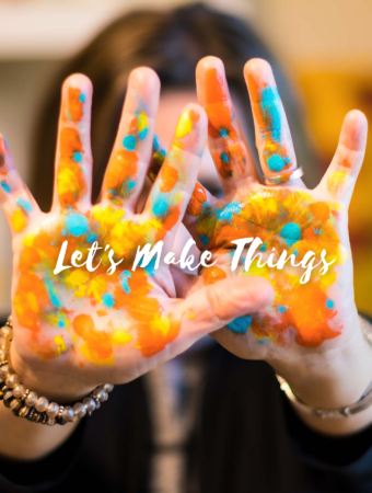 "Painted hands with the words ""let's make things"""