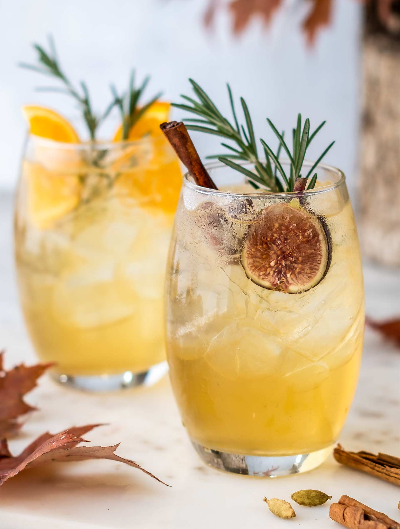 Close up photo of two glasses of fall sangria